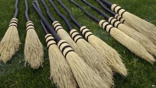 A pile of broomsticks