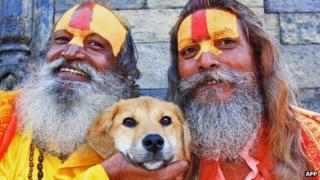 Rupee posing with Hindu saddhus (holy men) in Kathmandu