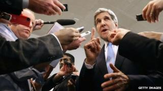 US Secretary of State John Kerry speaks with reporters at the U.S. Capitol before testifying to the Senate Banking and Urban Affairs Committee 13 November 2013