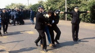 A miner arrested by police at Orgreave