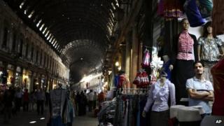 A Syrian shopkeeper waits for customers at the popular Hamidiyeh old market (file photo)