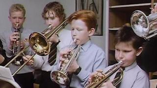 Schoolboys playing brass