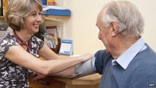 A GP taking a patient's blood pressure
