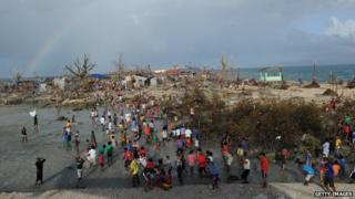 Children play in Guiuan in the aftermath of the typhoon