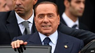"Italian former Prime Minister Silvio Berlusconi (R) leaves after the People of Freedom (PDL) party""s national convention in Rome on 16 November 2013."