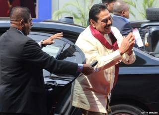 Sri Lankan President Mahinda Rajapaksa arrives for the final day of the summit in Colombo, 17 November