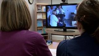 Doctors and patients using telemedicine