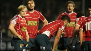 Scarlets players at end of Saracens