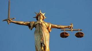 The figure of Lady Justice at the top of the Old Bailey