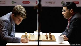 India`s Viswanathan Anand (right) plays against Norway`s Magnus Carlsen during the Norway Chess May 9, 2013.