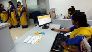 "An all-female bank staff are pictured at their terminals during the inauguration of the first branch of the Bharatiya Mahila Bank (BMB), India""s first state owned women""s bank, in Mumbai on November 19, 2013."
