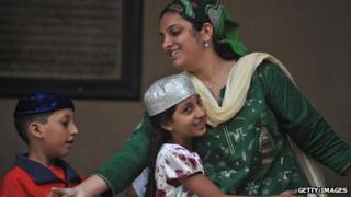 An Indian Parsi family at prayers