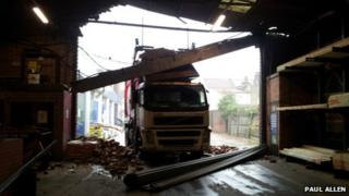 Truck surrounded by debris in warehouse