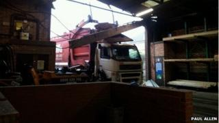 Side view of truck in warehouse
