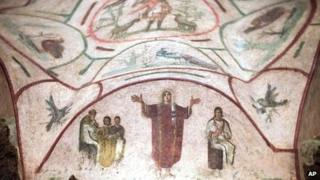 Fresco with a figure with outstretched hands