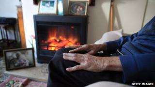A pensioner with his gas fire on