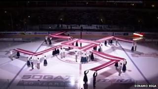 The Latvian fire cross symbol at an ice hockey match in Riga