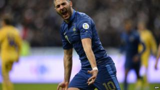 France's forward Karim Benzema celebrates after scoring his team's second goal
