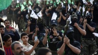 Masked men carry rocket-propelled grenades on 14 November 2013