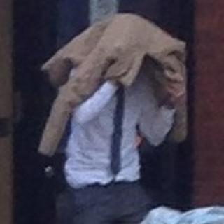 Lee Hunt hiding beneath his coat