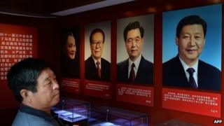 Portraits of the Chinese President Xi Jinping (right) along with his predecessors