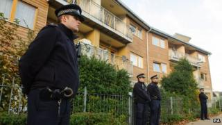 Police officers patrol near flats in Brixton, south London