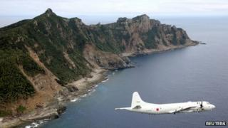 Japan Maritime Self-Defense Force's PC3 surveillance plane flies around the disputed islands in the East China Sea, known as the Senkaku isles in Japan and Diaoyu in China, in this October 13, 2011 file photo