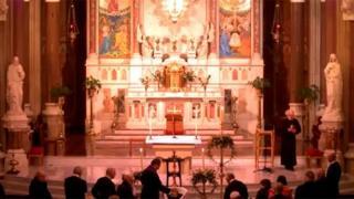 Fr Alec Reid lying in repose at Clonard Church