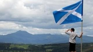 Saltire overlooking Scottish hills