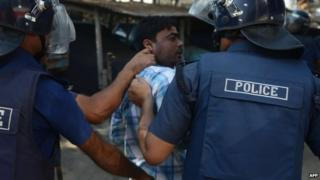 Bangladeshi police detain a BNP supporter following clashes during a blockade organised by Bangladesh Nationalist Party (BNP) activists and its Islamist allies in Aminbazer, in the outskirts Dhaka on November 26, 2013.