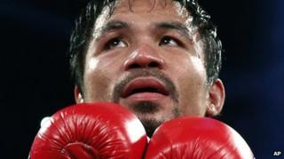Manny Pacquiao of the Philippines celebrates after winning his WBO international welterweight title fight against Brandon Rios, Nov 24th