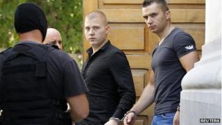 Eugen Darie, (left) and Radu Dogaru leave court Aug 2013