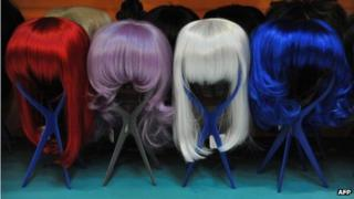 Coloured wigs on display