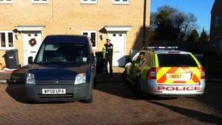 Police outside Peterborough house of couple arrested after toddler with serious injuries died in hospital