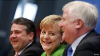 Party leaders Chancellor Angela Merkel (C) of the Christian Democratic Union (CDU), Horst Seehofer (R) of the Christian Social Union (CSU) and Sigmar Gabriel of the Social Democratic Party (SPD) attend a news conference after signing a preliminary coalition agreement on 27 November 2013