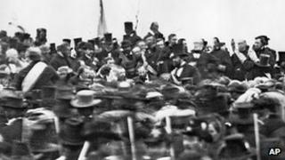 President Abraham Lincoln surrounded by the crowd at the dedication of a portion of the battlefield at Gettysburg as a national cemetery in 1863