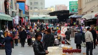 This picture taken on 6 November 2013 shows a crowd of mainly Uighur shopping at a bazaar in Hotan, far west China's Xinjiang region
