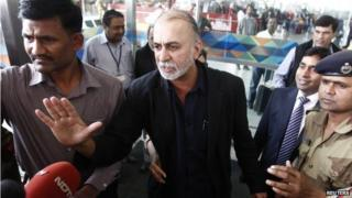 """Tarun Tejpal, the 50-year-old founder and editor-in-chief of India""""s leading investigative magazine Tehelka, speaks with the media upon his arrival at the airport on his way to Goa, in New Delhi November 29, 2013."""