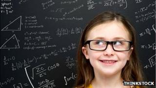 Girl by a blackboard