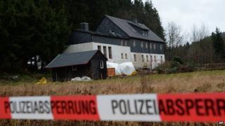 Police cordons block a property near Reichenau, eastern Germany Friday Nov. 29, 2013