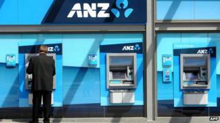 A customer using an ANZ ATM