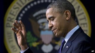 President Barack Obama waves in Washington DC on 2 December 2013