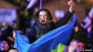 A woman shouts slogans and holds a Ukrainian flag as she takes part in an opposition rally at Independence Square in Kiev on December 2, 2013.