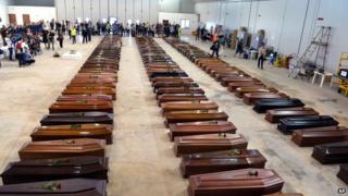 Coffins of migrants who drowned off Lampedusa on 3 October, laid out at Lampedusa airport, southern Italy