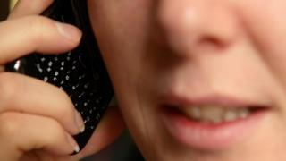 Phone conversation (posed)