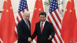 Chinese President Xi Jinping (right) shakes hands with US Vice-President Joe Biden (left) inside the Great Hall of the People in Beijing 4 December 2013