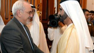 Mohammad Javad Zarif with UAE Prime Minister and Dubai ruler Sheikh Mohammed bin Rashid on 4 December 2013