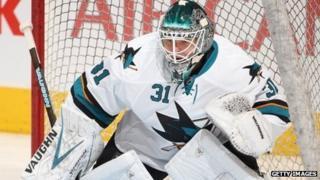 San Jose Sharks goalie Antti Niemi warms up before game on December 3, 2013.