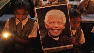 Children with a photograph of Nelson Mandela
