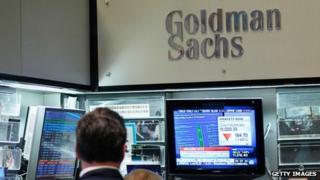 Goldman Sachs logo and trader